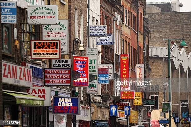 Signs for businesses on Brick Lane which is synonymous with curry restaurants March 16 2011 in London England From April 2011 the Government has...