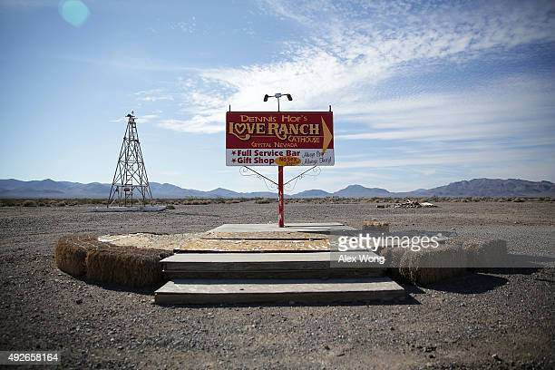 Signs for Dennis Hof's Love Ranch Las Vegas brothel are shown on October 14 2015 in Crystal Nevada Former NBA player Lamar Odom was found unconscious...