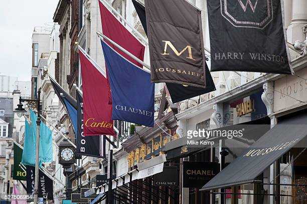 Signs for high end fashion and exclusive brands on Old Bond Street London UK