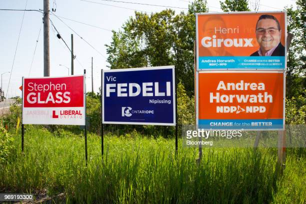 Signs for Nipissing candidates Stephen Glass Ontario Liberal Party candidate Vic Fedeli leader of the Progressive Conservative Party of Ontario Henri...