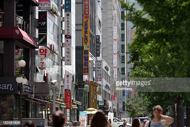 Signs for plastic surgery clinics are displayed on the side of a building in the Sinsadong area of Gangnam district in Seoul South Korea on Saturday...