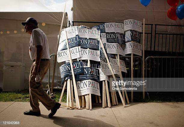 Signs for Republican presidential candidate Rep Ron Paul are stacked outside the Hilton Coliseum where Iowans will vote in the Iowa Straw Poll at...