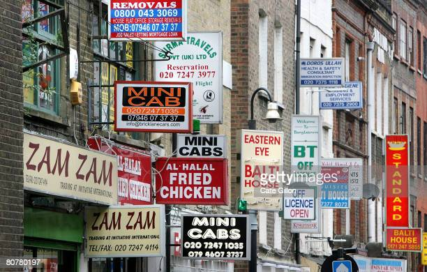 Signs for restaurants and businesses on Brick Lane on April 19 2008 in London England Tomorrow is the anniversary of politician Enoch Powell's River...