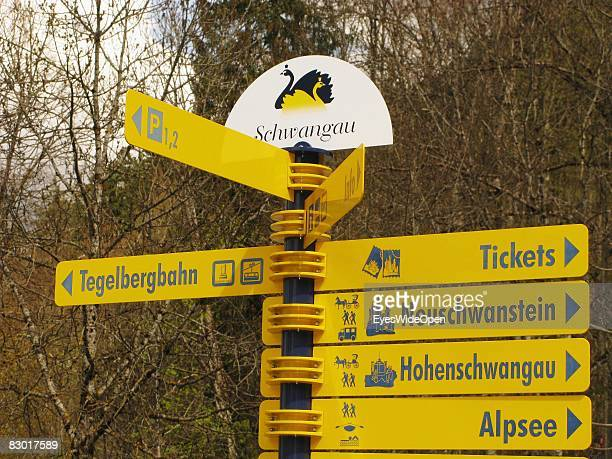 Signs for sightseeing tours to Neuschwanstein Castle or Hohenschwangau Castle on September 24 2008 in Hohenschwangau Ostallgaeu Germany The castle...