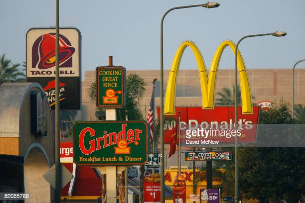 Signs for Taco Bell Grinder McDonalds Panda Express fastfood restaurant line the streets in the Figueroa Corridor area of South Los Angeles on July...