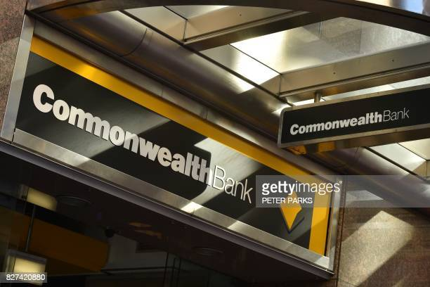 Signs for the Commonwealth Bank are seen outside a branch in the central business district of Sydney on August 8 2017 Australia's Commonwealth Bank...