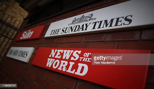 Signs for the four newspapers belonging to News International dominate the entrance at the Wapping production plant on July 7 2011 in London England...