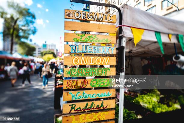 signs for vegetables and greens for sale - farmers market stock pictures, royalty-free photos & images