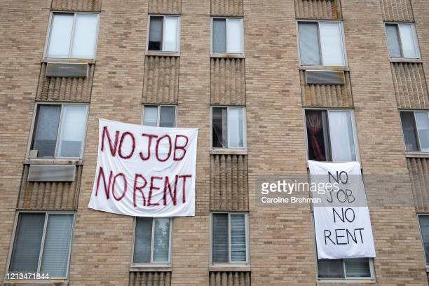 Signs hang from the Meridian Heights apartment building in Northwes Washington on Monday May 18 2020