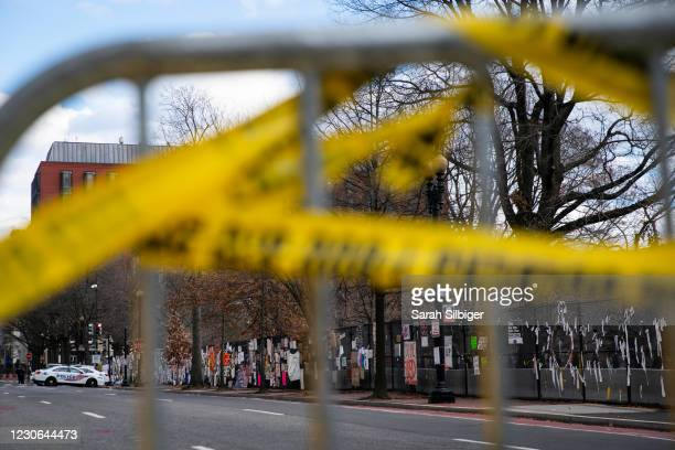 Signs hang on the fence near Black Lives Matter Plaza within the expanded protective perimeter around the White House ahead of this week's...