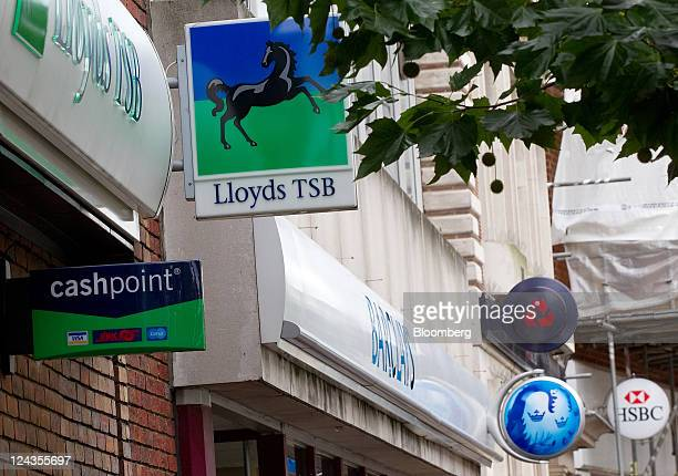 Signs hang outside branches of Lloyds TSB Natwest Barclays and HSBC banks in Staines UK on Friday Sept 9 2011 The Independent Commission on Banking...