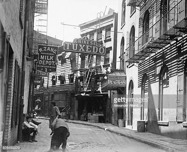 Signs hang over narrow Doyers Street in Manhattan's Chinatown   Location Chinatown Manhattan New York New York USA