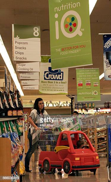 Signs hanging from the ceiling at an Albertsons store in Fullerton announcing the labeling campaign to make it easier for shoppers get the...