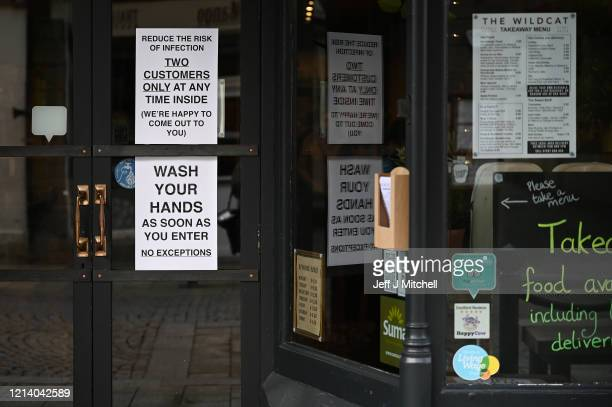 Signs in a coffee shop in Main Street Fort William as people are asked to stop traveling to the Scottish Highlands in a bid to avoid spreading the...