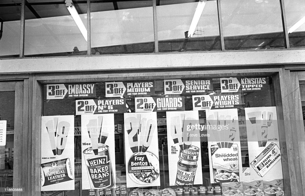 Signs in a shop window in London's East End, circa 1970.