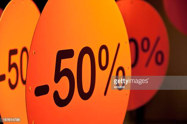 SALE signs in a shop window