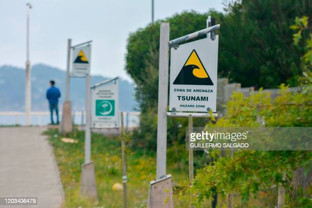 Signs in Dichato Chile 519kms south of Santiago de Chile on February 24 direct resident to tsunami evacuation routes A decade after the powerful...