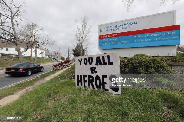 Signs in front of Huntington Hospital salute the medical workers on April 10, 2020 in Huntington, New York. According to Johns Hopkins University,...