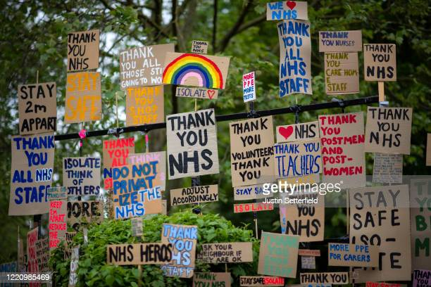 Signs in support of the NHS are seen in East London on April 25 2020 in London England The British government has extended the lockdown restrictions...