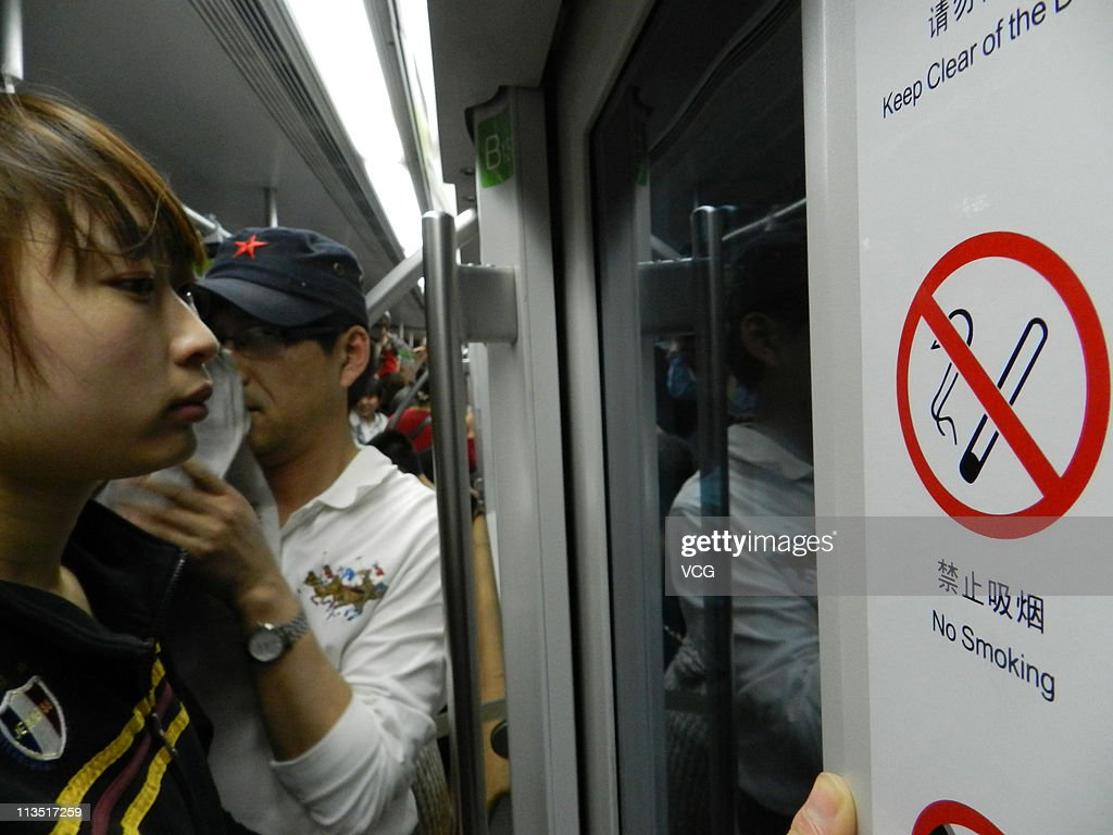 Signs in the Beijing Subway Line 1 warn 'No Smoking' May 1, 2011 in Beijing, China. China's health ministry has issued a ban on smoking in all public indoor spaces, including public transportation, restaurants, Internet cafes and bars; the ban went into effect on May 1, 2011.
