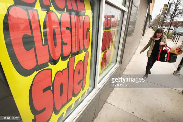 Signs in the window of a Sears store advertise the store's closing on May 3 2018 in Chicago Illinois The store which opened in 1938 is the city's...