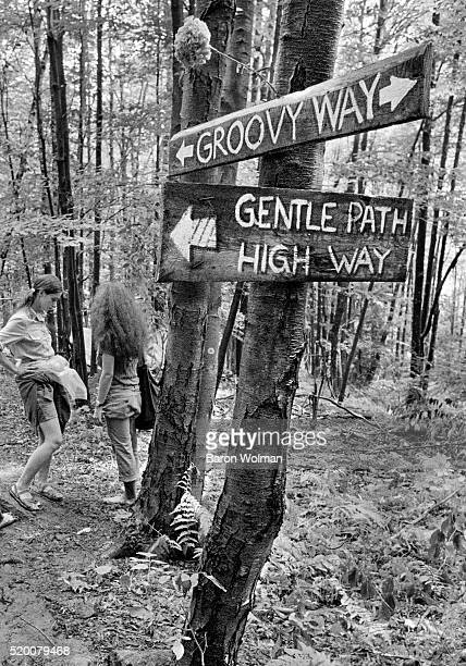 Signs in the woods at the Woodstock Music Art Fair Bethel NY August 15 1969