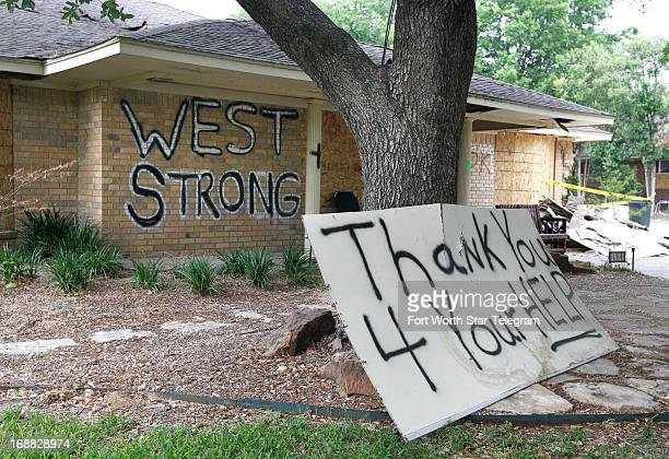 Signs in yards and painted on homes are common like this one on Davis St in West Texas May 9 2013