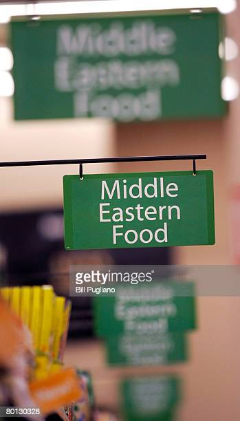 Signs indicate the large Middle Eastern food aisle at a new multilingual WalMart that will stock the largest selection of Middle Eastern food of any...