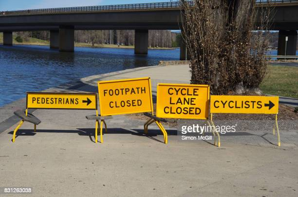 signs indicating closed foot- and cycle-paths at lake burley griffin near commonwealth avenue, canberra, australian capital territory, australia - detour sign stock photos and pictures
