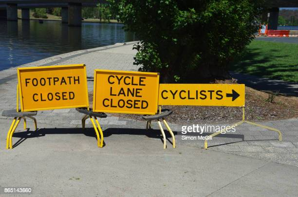 signs indicating closed footpath and cycle lane at lake burley griffin near commonwealth avenue, canberra, australian capital territory, australia - detour sign stock photos and pictures