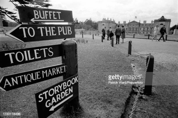 Signs indicating directions to various attractions at Woburn Abbey and Gardens in Bedfordshire, in the background, circa July 1969. From a series of...