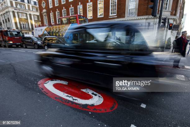 Signs indicating London congestion charges that drivers pay for entering the capital's central areas which British financial services group Capita...