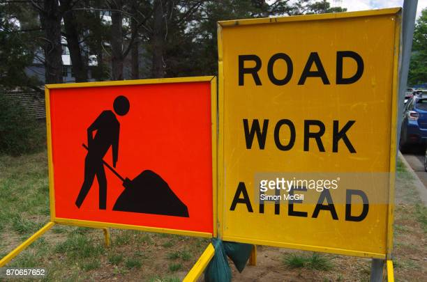 Signs indicating roadwork ahead