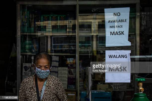 Signs indicating that face masks are sold out are seen at a medical supply shop, as public fear over China's Wuhan Coronavirus grows, on February 3,...