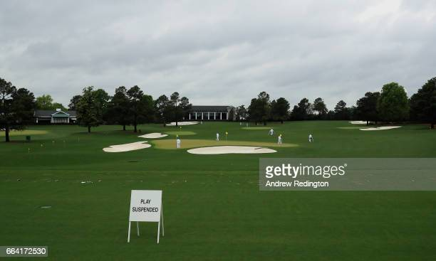 Signs indicating that play is suspended due to inclement weather are displayed on the driving range during a practice round prior to the start of the...