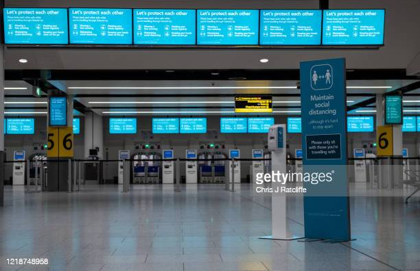 Signs inform passengers of new safety measures against the spread of covid-19 inside the currently closed North Terminal at Gatwick Airport on June...