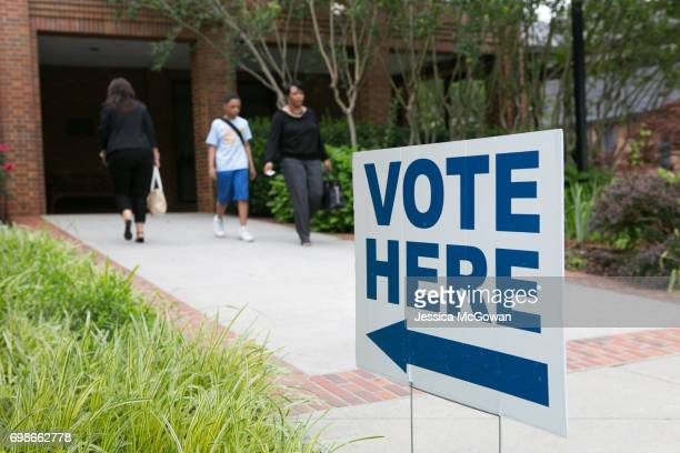 Signs lead voters into the polling location at St Martin In The Fields Episcopal Church for the special election of Georgia's 6th Congressional...