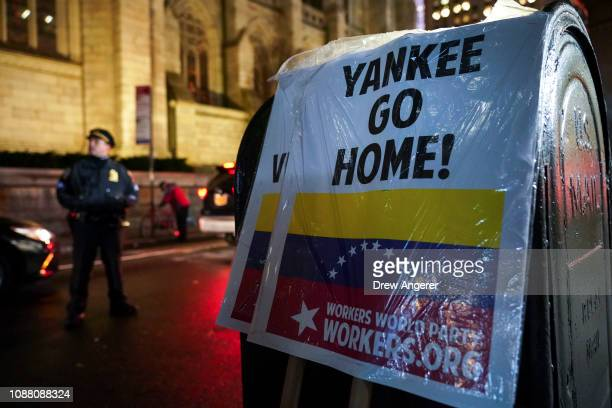 Signs left by protestors signal support of Venezuelan President Nicolas Maduro outside the Venezuelan Consulate in Midtown Manhattan January 24 2019...