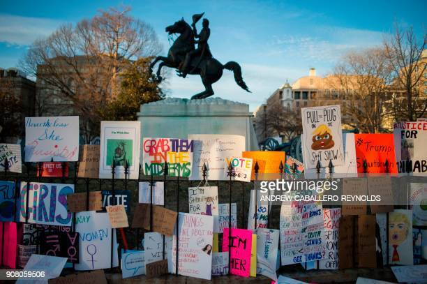 Signs left in Lafayette Square are seen after the Women's March on Washington 2018 March On The Polls on January 20 2018 in Washington DC / AFP PHOTO...
