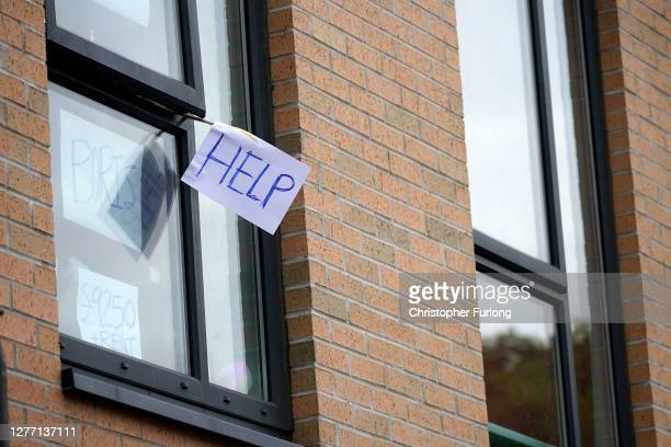 Signs made by students are displayed in a window of their locked down accommodation building on September 28, 2020 in Manchester, England. Around...