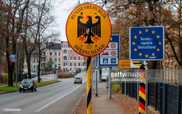 Signs mark the entrance into Germany from Poland on a road bridge over the river Neisse that links the Polish city of Zgorzelec to the German city of...