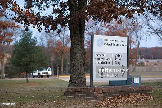 Signs mark the entrance to the federal correctional center where former Illinois Gov George Ryan will be reporting on November 7 2007 in Oxford...