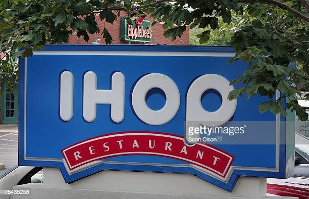 Signs mark the locations of neighboring IHOP and Applebee's restaurants July 16 2007 in Elgin Illinois IHOP has agreed to purchase the Applebee's...