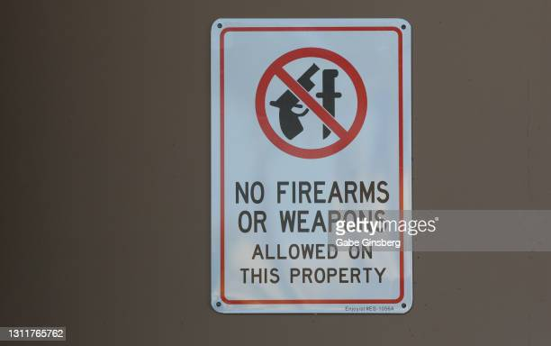 signs: no firearms or weapons allowed on this property - gun control stock pictures, royalty-free photos & images