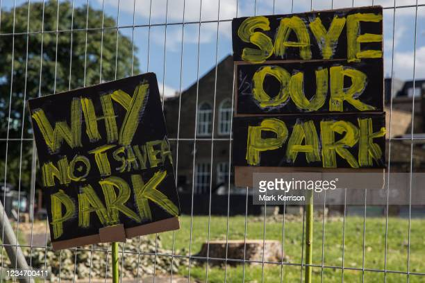 Signs objecting to Southwark Council's plans to develop Peckham Green as public housing are pictured on 14th August 2021 in London, United Kingdom....