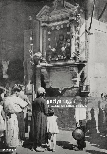 Signs of devotion in working class areas of Naples Italy photo by Bruni from L'illustrazione Italiana year LXI n 38 September 23 1934