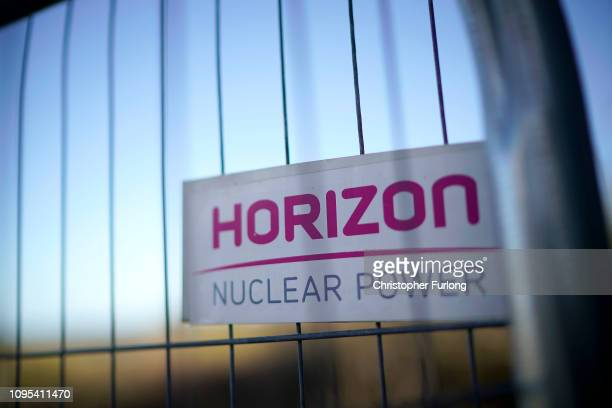 Signs of Hitachi subsidiary Horizon Nuclear Power adorn fencing surrounding the location of the new Wylfa Newydd reactor at Anglesey on January 17...