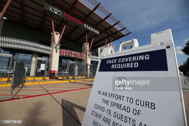 Signs of social distancing are displayed at the entrance of the stadium during a game between FC Dallas and Nashville SC as part of the Major League...