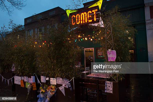 DECEMBER 6 Signs of support hang on the building at Comet Ping Pong in Washington DC on Tuesday December 6 2016 The business is set to reopen after...