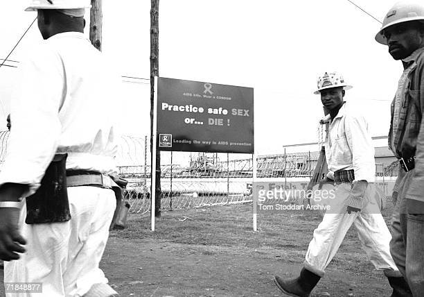 Signs Of The Times A sign warning miners about the dangers of HIV/AIDS at the Lonmin platinum mine in the Marikana area of South Africa 17000 men...